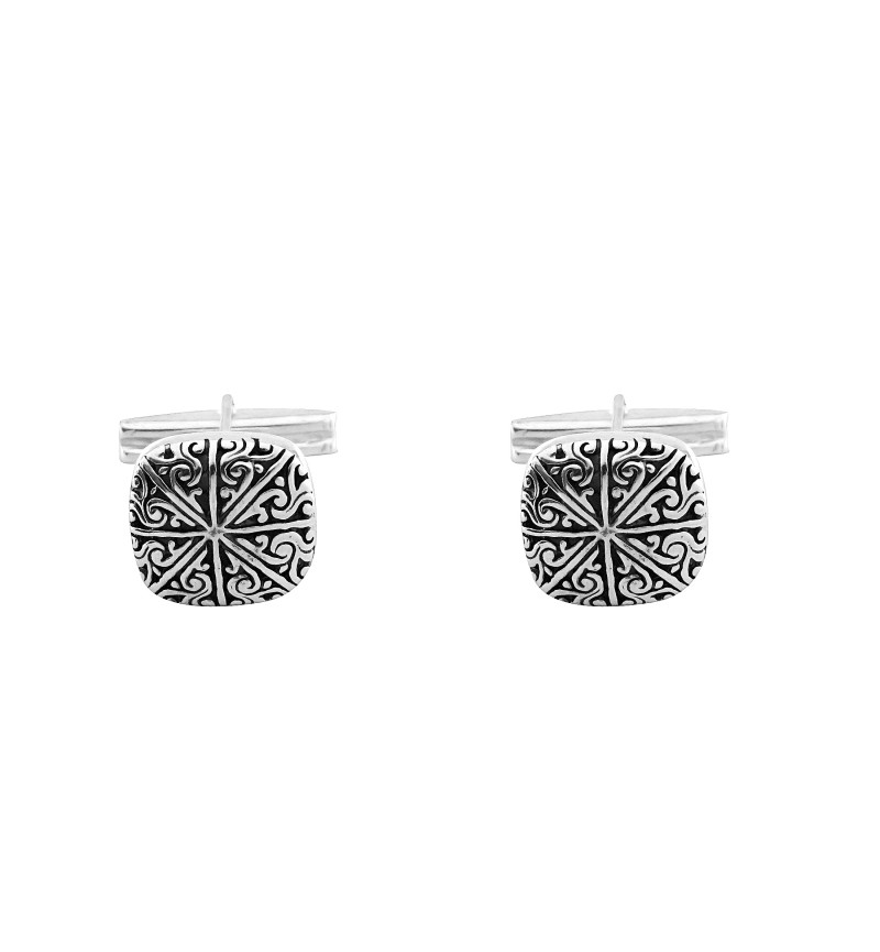 Cufflinks with embossed design